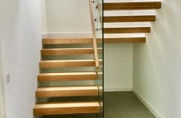 Cantilevered stairs with single centre glass. Ideal to maximise lightwell opening